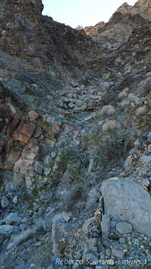 The gully. A mix of solid rock and loose stuff. Not the best route but it goes.