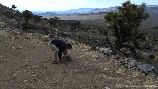 Robin busts out the big guns to move rocks so that we have room to turn around the trucks.
