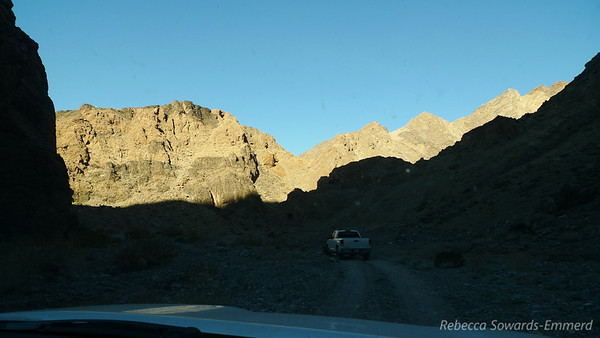 Fred's Tundra in the shadows, heading up the canyon ahead of us.