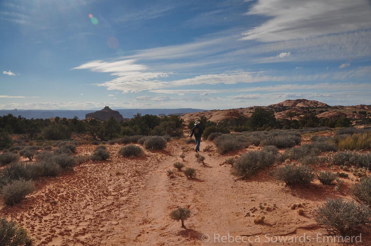 David walking down the path towards the false kiva