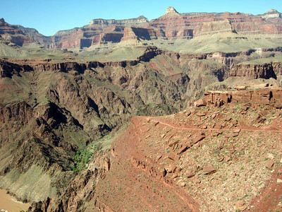 The trail hugs the canyon walls