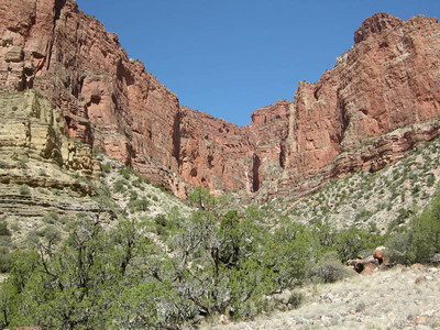 The red walls of a side canyon