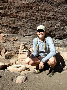 Me at the ruins, next to a granary and metates