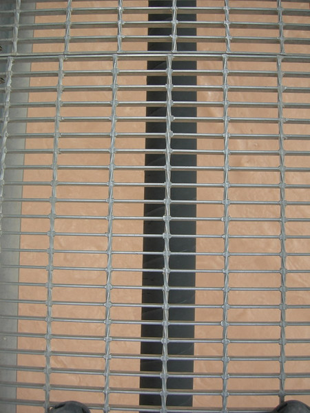The water pipe and grating.<br /> <br /> Kind of unnerving when you see the violent eddies below