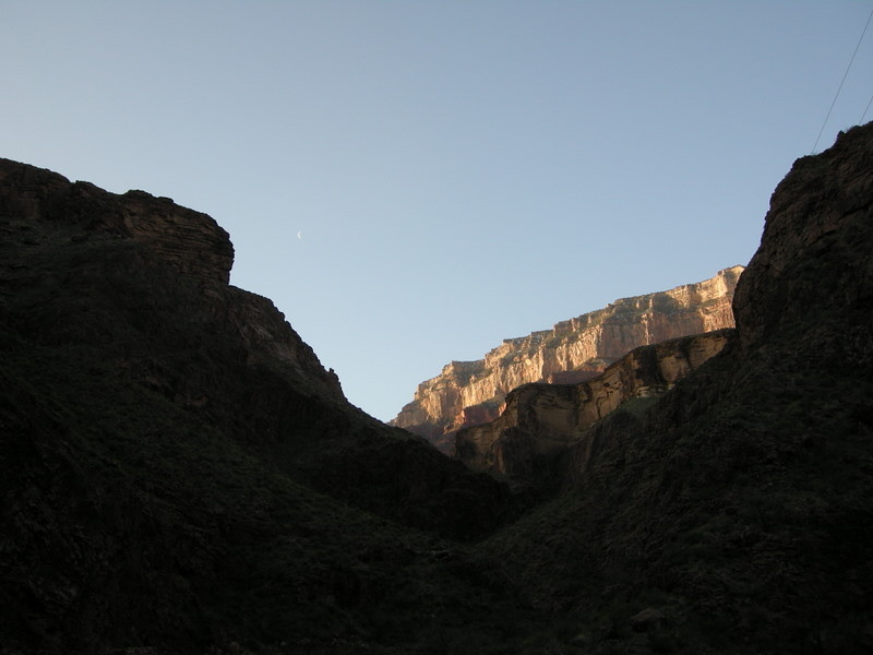 The sun hits the canyon walls above<br /> <br /> Some of the phone lines are visible in the right of the photo