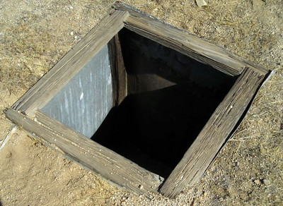 cooler? A metal lined 4 foot deep pit.