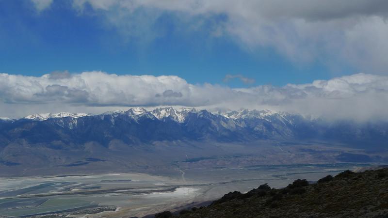 Sierra view - most peaks just in the clouds. Mt Whitney ~5000 feet higher than us, Owens Valley ~5000 feet below.