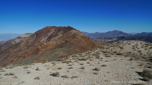 Closer to Mt Perry. Almost out of the white and into the red volcanic rock.