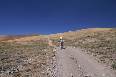 Walking the road. All tire tracks, no footprints. We're bagging this peak old skool.