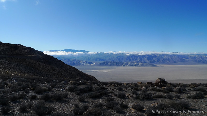 Next we drove up to the shoulder of Lead Peak, then hiked the narrow ridge to the summit. View from the parking area towards the Hidden Dunes notch