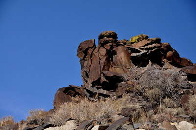 The prominence at the end of the ridge, covered with glyphs