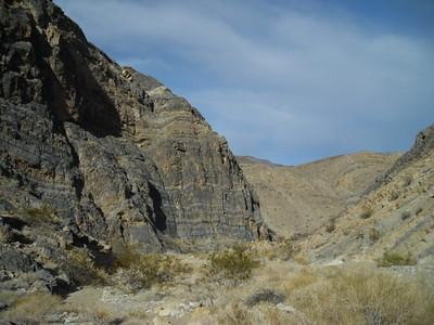 Still a wide wash-like canyon