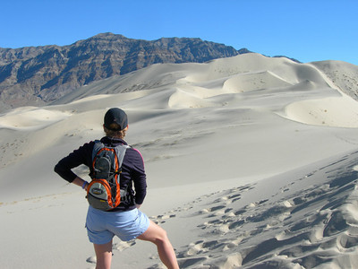 A beautiful day at the Eureka Dunes  Bex pausing before the climb up to the crest of the dune mountain