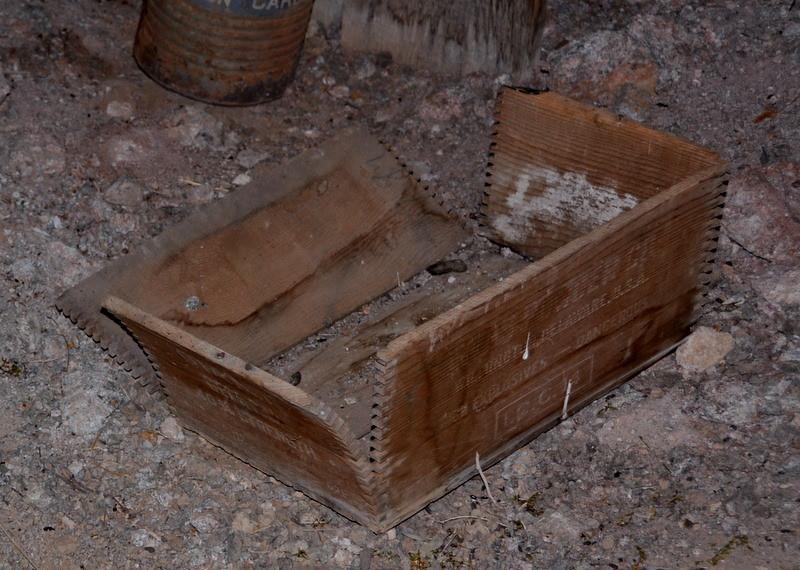 Empty explosives box in the main mine tunnel.