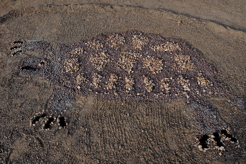 Nice ad-hoc rock and charcoal mosaic at Owl Canyon campground in Rainbow Basin