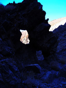 Canyon by camp  After fossil hunting at camp, I wandered back up the gap to a small canyon and found this arch.