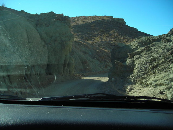 View from the car through the 'narrows' of the drive.<br /> <br /> We did this a few years ago and I remember the road being rouger. It was smooth and graded this time, easily passable in a passenger car.