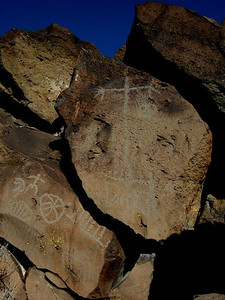 Along the way, we run into some amazing pictographs  Photo is darkened to show the carvings - I like the headless shaman (holding a head in his left hand)