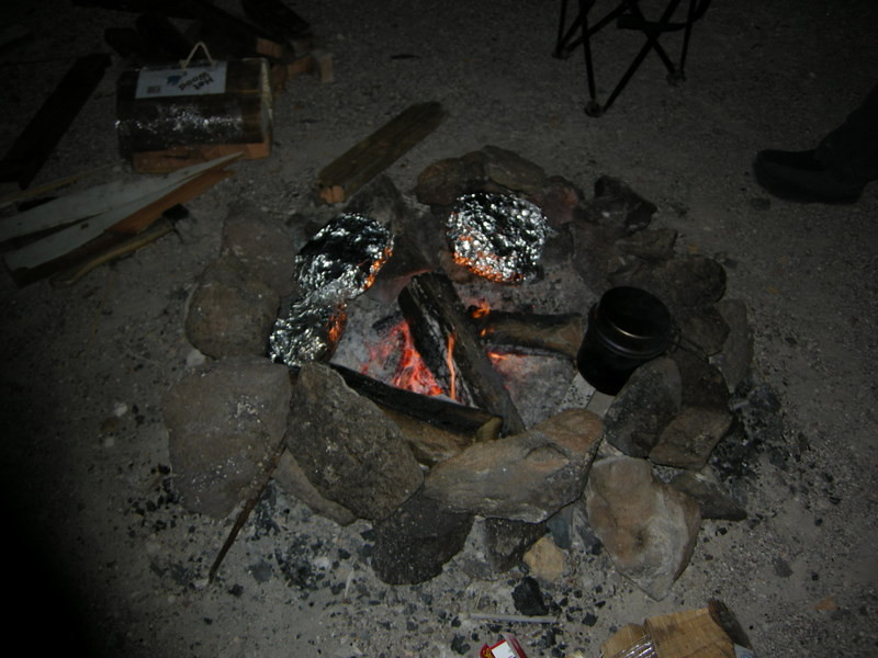 That's some turkey, stuffing, rolls, and other Thanksgiving goodies keeping warm around the fire.