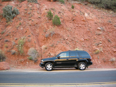 The (clean) truck contrasts with the red rock.