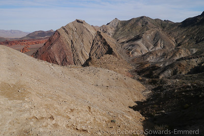 The best view of our route so far: WE came across pinto valley (left, red rocks), then up the canyons in front of the multi colored outcropping just left of center. We then took a right and came up the gentle canyon/wash to our current perch at the saddle.
