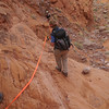 Heading down the wet sandstone.