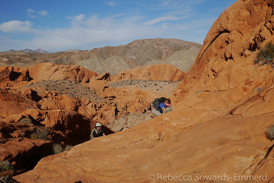 Scrambling up the red rock.