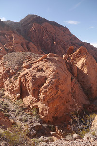 We're passing through the red rock layer on our way to the limestone upper ridge.