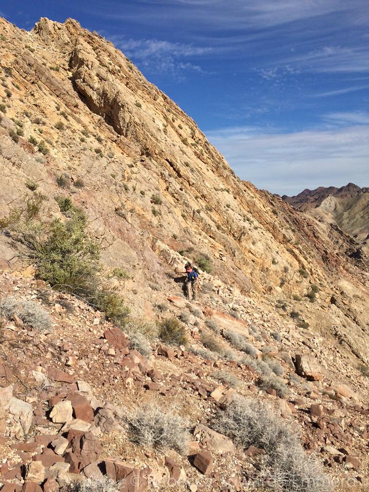 Crossing some bigger loose stuff below the peak.