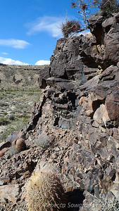 Scrambling up the rocks to get a closer look at the space invader glyph.