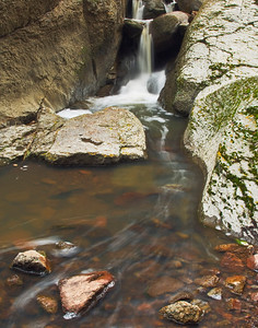 Yet another perspective using rocks as foreground anchors and capturing more of the creeks fluidity.