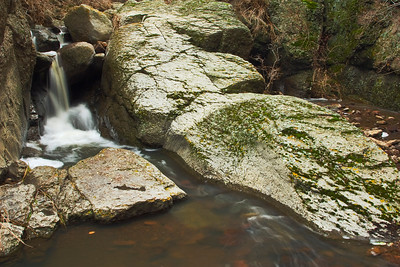 This is a different view of the same waterfall.  The second waterfall is behind the rock and hidden.  I especially like the smooth rock formed by the creek's flow.
