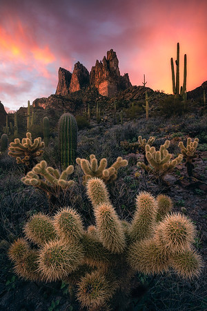 A gorgeous sunset burns over Three Sisters summit, Arizona