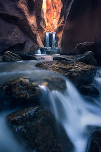 An amazing slot canyon with a river flowing through, Utah