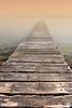 Photo of small bridge entering the morning mist