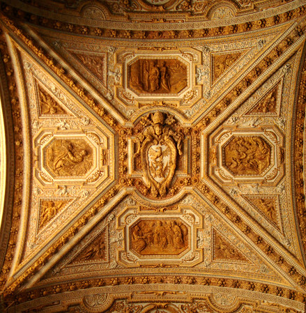 "The Ceiling at St. Peter's Basilica.<br />  <br /> The Basilica of Saint Peter, officially known in Italian as the Basilica di San Pietro in Vaticano and commonly known as St. Peter's Basilica, is located within the Vatican City. It occupies a ""unique position"" as one of the holiest sites and as ""the greatest of all churches of Christendom"". In Catholic Tradition, it is the burial site of its namesake Saint Peter, who was one of the twelve apostles of Jesus and, according to Tradition, was the first Bishop of Antioch, and later first Bishop of Rome and therefore first in the line of the papal succession. While St. Peter's is the most famous of Rome's many churches, it is not the first in rank, an honour held by the Pope's cathedral church, the Basilica of St. John Lateran"