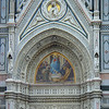 "Portal decoration on the main building of the Cathedral of Florence.<br /> <br /> Santa Maria del Fiore (also known as the Duomo) is the cathedral of Florence, Italy, noted for its distinctive dome. <br /> <br /> Its name (""Saint Mary of the Flower"") refers to the lily, the symbol of Florence. The cathedral complex includes the Duomo, the baptistery and the campanile (bell tower)."