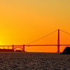 The most romantic scene ever.  Golden sunset over the Golden Gate Bridge in San Francisco.