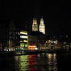 Grossmunster by night.  The twin towers of Zurich's Grossmunster Church faceing the River Limmat and have become the most recognizable symbols in Zurich. Originally endowed by Charlemagne, parts of this church date back to the 11th and 13th centuries. Although cleansed of much ornamentation during its break from Papal tyranny, there are still remains of a Romanesque cloister, 12th-century statuary and more recently added stained glass in the choir by Augusto Giacometti