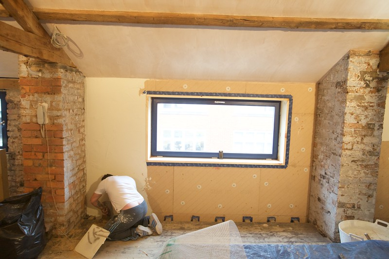 triple glazed windows, insulated solid timber reveals, air seal tape to wood fibre insulation