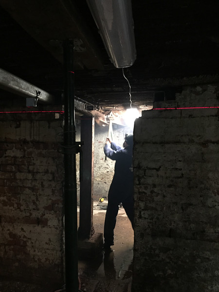 barry removing rotten steel from beneath the ground floor