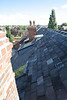 the back roof newly reroofed with recycled slate