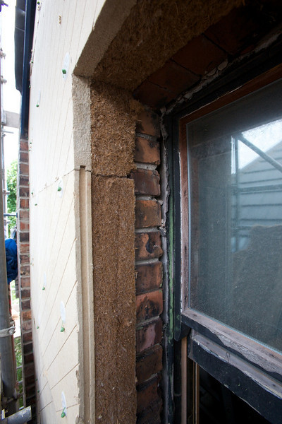wood fibre insulation before installation of stainless steel reveal