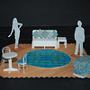 Act 1: Paris drawing room.<br /> Floor boards centre stage (might not work for Yerma though?)<br /> Sofa(bed) in white with white foam seat, green/blue patterned scatter cushions across it. Large blue/green rug. Patterned fabric loose cover over ottoman. Blue/green seat cushions on white bentwood chairs. White side table by sofa. Could add set dressing such as vase of flowers on table, phone & ash tray on side table, magazines on ottoman?
