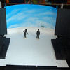 Bottom horizon piece built in wood as a cut-out and in front of and slightly away from the painted backdrop