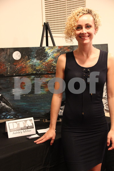 Desiring The Arts took place at McSweeney's School of the Performing Arts on Thursday, August 25, 2016 in Fort Dodge. The event offered a wide variety of music, artists, and performers. One of the artists at the event is Ashley Miller,  pictured here with one of her pieces of art.