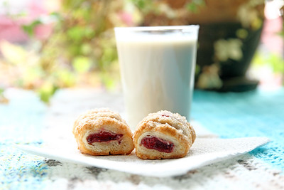 Rasperry pastry treats with glass of almond milk for breakfast