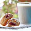 Raspberry bites pastries with a glass of almond milke