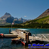 Many Glacier Hotel view of Mount Wilbur and other glaciated peaks encircling the boat dock on crystalline Swiftcurrent Lake within Glacier National Park (USA MT Babb)