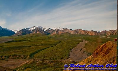 Dry washes and grasslands frame Denali or Mount McKinley from Denali Park Road within Denali National Park(USA Alaska Denali Park)